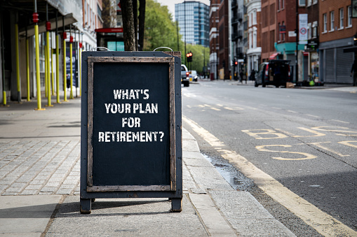 "Unexpected retirement. Sign outside on sidewalk with the words ""What's your plan for retirement?"""